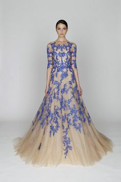 The blue lace appears to float over the surface of the chiffon.  Monique Lhuillier pre-fall 2012.