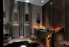 carrelage noir avec des bougies dans la salle de bain
