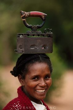 smile from Madagascar/AWWWW an Iron on her head,gorgeous smile on her face.