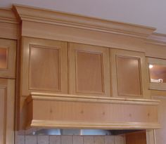 Timeless Hood produced from natural maple raised panels