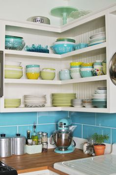 This open shelving idea in the corner where my cabinets are has intrigued me for a while.  Really considering it and I love the beadboard back to it.