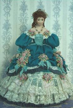 Miniature Doll in period dress.  The skirt embellishments are fabulous!