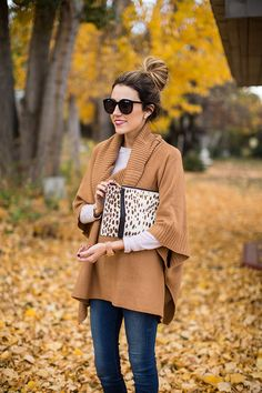 Turtleneck poncho with layering tee; high bun; double-sided pearls