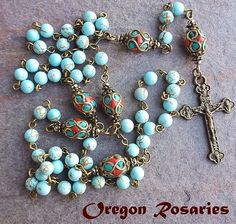 "Nice howlite turquoise rosary with bronze toned center and crucifix. Stunning handmade mosaic ""Paters"" make this a unique rosary. Rosary opening is approx. This is actual rosary you will receive. Created using smooth 6mm Howlite turquoise beads for the Aves. 