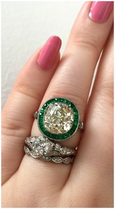 A stunning antique engagement ring from Jewels by Grace, with a delicious antique center stone and an emerald halo. Spotted at Metal and Smith.