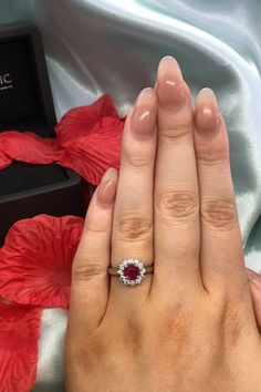 Looking for a beautiful autumn accessory? Treat yourself to this ruby ring, enhanced with a sparkling diamond halo.