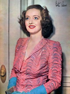 Bette Davis looking gorgeous in a pin, periwinkle and sky blue evening look. #vintage #1940s #actresses #fashion #gloves