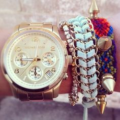 Gold watches with colorful bracelets.