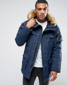 Get this Nicce London's parka now! Click for more details. Worldwide shipping. Nicce London Grand Parka With Faux Fur Hood - Navy: Parka by Nicce London, Midweight woven fabric, Quilted lining for extra warmth, Lined with internal pocket, Adjustable hood, Faux-fur trim, Zip fastening, Drawstring midsection, Functional pockets, Regular fir - true to size, Dry clean, 100% Polyester, Our model wears a size Medium and is 178cm/5'10 tall.  (parka, parka, anoraks, anorak, chaqueta larga, parka…