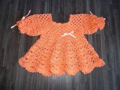 Gehaakt jurkje met lange mouw: http://link.marktplaats.nl/m953986867