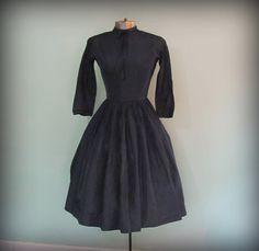 Vintage 1950s Navy Blue Full Skirt Long Sleeve Dress by Jean D' Arc size Small. $46.00, via Etsy.