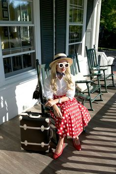 Skirt:ASOS(also love this gingham trench), Shoes: Chanel (similar). Top:Phillip Lim. Hat:Eugenia Kim. Bag: Chanel. Suitcase:Steamlinec/o. Sunglasses: Celine. Scarf:Club Monaco.