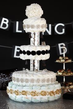 Bling Baby Diaper Cake. Four-tiered diaper cake with 100 HUGGIES® Pure & Natural Diapers featuring glamorous mirrored accents.