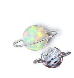 "gimel / In Ethiopian language ""Beauty"" is ""Konjo"". This brooch is made with ""opal with konjo"" representing Saturn. [ Brooch : 950 Platinum, Opal, Diamond ]"