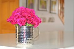 10-Minute Kitchen Rejuvenation: monochromatic blooms in a cute mug and a decluttered kitchen island.