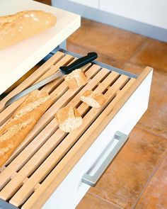 What a great idea - a pull-out kitchen drawer for cutting bread and the breadcrumbs fall directly into the bin below