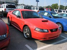 2004 Mustang GT 40th Anniversary edition in competition orange.  (just like mine)