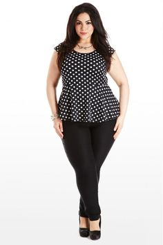 Love this curvy fashion: black polka dot peplum top with black pants and pumps. #plussize