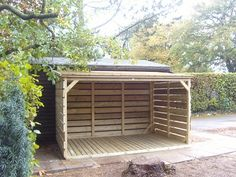 A bespoke cycle shed/log store.