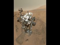 "NASA - High-Resolution Self-Portrait by Curiosity Rover Arm Camera - On Sol 84 (Oct. 31, 2012), NASA's Curiosity rover used the Mars Hand Lens Imager (MAHLI) to capture this set of 55 high-resolution images, which were stitched together to create this full-color self-portrait.    The mosaic shows the rover at ""Rocknest,"" the spot in Gale Crater where the mission's first scoop sampling took place. Four scoop scars can be seen in the regolith in front of the rover."