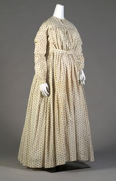 Vintage Fashion: And ivory cotton maternity day dress with a brown floral print. Circa 1865. Photo Credit: Kent State University Museum.