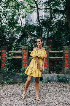 Mustard colored off shoulder dress. tokyo_travel_guide-outfit-collage_vintage-street_style-off_the_shoulders_dress-mustard_dress-soludos_sandals-chanel_vintage-bag-vintage_stores-25