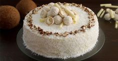 Almond Coconut Cake (Raffaello cake) :: This delicate and elegant cake is made with an almond sponge cake, a white chocolate, Mascarpone and coconut filling and topped with Raffaello Truffles, chopped almonds, white chocolate curls and shredded coconut. Food Cakes, Cupcake Cakes, Cupcakes, Melting Chocolate, White Chocolate, Chocolate Curls, Chocolate Truffles, Raffaello Cake Recipe, Almond Coconut Cake