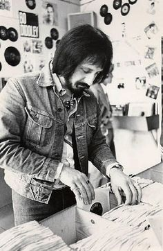 John,looking at singles,for his record collection.