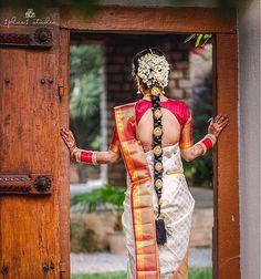 South Indian bride. Gold Indian bridal jewelry.Temple jewelry. Jhumkis.Red and white silk kanchipuram sari.Braid with fresh jasmine flowers. Tamil bride. Telugu bride. Kannada bride. Hindu bride. Malayalee bride.Kerala bride.South Indian wedding.