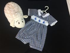 Dashing little gingham romper with hand-embroidered sailing boats