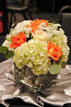 E+S: White hydrangeas as big flowers?  Not sure about hydrangeas in fall, but this makes it a little better with the orange