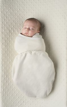 Four Project Nursery readers will win an Ergobaby Swaddler (a $25 value)