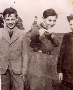 Adam Wnuczek at the age of 12, with two other boys in the ghetto, Cracow, Poland 1941