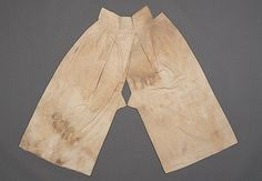 """Baji (Pants) belonging to Gho Yeo-gwan. 1530~1580.   Excavated in Ilyoung, Kyeonggi-do.  (L)97cm   (Waist)86cm    (Waistband Width)10cm.    """"Double layered pants made of cotton and lined with cotton.... It looked similar to female open clutched baji which has triangle shaped gusset patched on open clutch bottom."""" Dankook University Seok Juseon Memorial Museum."""