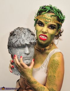 Lauren: I'm wearing a Medusa Gorgon costume complete with my stone man head. My costume is completely hand put together and the make up and everything else was hand done by...