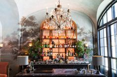 Spruce up your home bar and wow your guests with these eight chic and practical decorating ideas. Bar carts, French champagne ice buckets and bottle trees. Restaurant Design, Restaurant Bar, Roman And Williams, French Food, Beautiful Space, Big Ben, Nyc, Building, Places