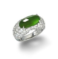 A jadeite and diamond ring  Set with an intense green elongated oval jadeite cabochon, measuring approximately 15.4 x 7.8 x 4.5mm, designed with a bow motif to each side set with tapered baguette-cut diamonds, between shoulders pavé-set with round brilliant-cut diamonds, mounted in platinum, the diamonds estimated to weigh approximately 3.00 carats in total