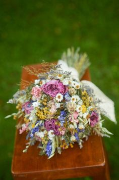 Bridesmaid bouquet made with medium pink peonies, billy balls, lavender, purple and pink larkspur, tansy(or yarrow, based on availability), flax, green wheat, oats, ammobium, and dried caspia. Variations are available, if desired, as all bouquets are made especially for you! (In some cases I may have to substitute similar flowers when a particular flower listed is out of stock.) Wedding photography courtesy of Jen Ing Photography jeningphtography.com  Two sizes available: Small measures…