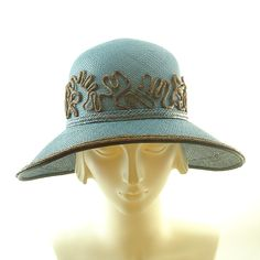 Teal & Brown Womens Cloche Hat Vintage Style by TheMillineryShopI hand blocked teal Panama straw on a vintage crown hat block and a sparterie ( a handmade hat form) made by me which makes it one of a kind. The shape is classic 1920's cloche hat with a round crown and wide brim. The brim edge has a wire in it with a grosgrain ribbon cover and hand dyed golden brown Panama straw trim.