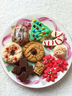 Christmas cookies!!  Snickers surprise, frosted sugar cookies, peppermint Rice Krispies, Spritz, goody bars, fudge & walnut fudge, peanut butter kisses & Rice Krispie wreaths.