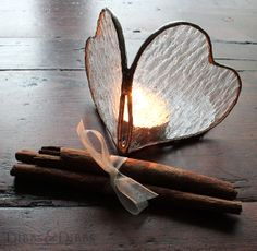 Handmade stained glass heart tealigjt candle holder http://www.dibbsanddibbs.com/collections/handmade-stained-glass-and-wooden-decorations/products/clear-textured-glass-heart-candle-holder-silver