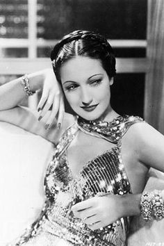 I look to her for inspiration on how to use my waist-length hair with vintage fashion.  Dorothy Lamour