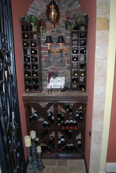Wine Closet, I love any closet that can store 148 bottles of wine!  Installed the Italian tumbled marble around the outside of the closet to frame it in.