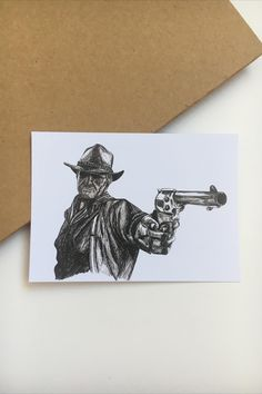 Inspired by Red Dead Redemption, this black & white postcard is perfect for collecting or sending to your pen pals. You can gift it too! Printed on sturdy matt card paper, this postcard is great for any cowboy fanatic!