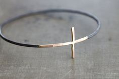 Gold Cross Sideways with Black Sterling Silver Bangle Bracelet on Etsy, £62.50