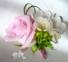rose-freesia-corsage by Blossom Wedding Flowers, via Flickr