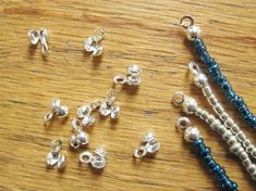 Use Bead Tips to Finish Your Beading Wire Designs...  Bead tips – also known as calottes, bead clamps, clam shells, bead ends and string tips, are a handy little finding that finishes the ends of beaded strands. String the end of your bead stringing material into the hole at the bottom of the bead tip. Anchor the cord or wire with a knot or crimp. Compress the two sides of the bead tip to hide the knot or crimp. Finish by attaching to the clasp with the bead tip loop.