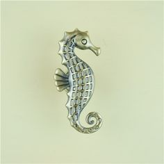 metal cabinet handle/seahorse cabinet handle This seahorse metal cabinet handle is a necessary home accessory. It is convenient for you to open the furniture and also makes your home look perfect. It is made of eco-friendly zinc alloy. The bronze finish is durable. Different size and color are available. We can also develop customized style, color and size as per your idea.For more pics, pls feel free to contact us.