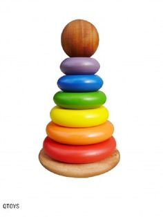 Rainbow coloured stacking rings with a rocking base.  This handcrafted wooden toy is by QToys and is in stock at www.ilovewoodentoys.com.au