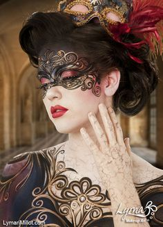 Beautiful and elegant airbrushed mask also the cracked effect on her hands arm and neck makes her look like an ornament